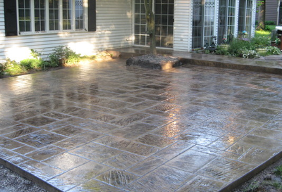 Kalamazoo stamped concrete job of a stamped patio outside a residential home in a subdivision.