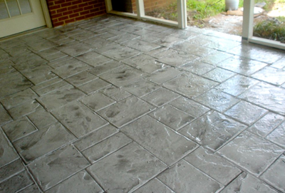Front entry porch with a stamped concrete design.